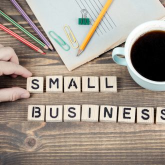 Small Business. Wooden letters on the office desk, informative and communication background