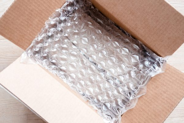 Plastic wrap with big bubbles in carton box