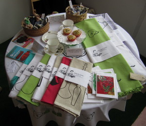 345633_display-of-work-for-sale--tea-towels-table-cloths-and-cards