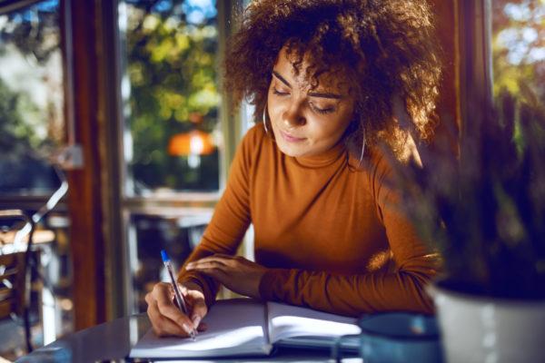 woman writing artist statement