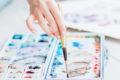 art school woman mixing paint colors brush palette