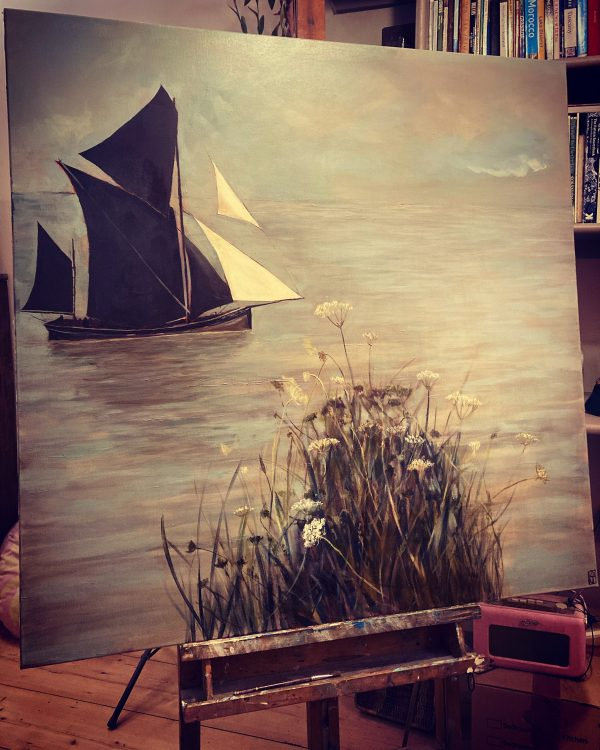 Painting of sailboat on the water with flowers in the forefront