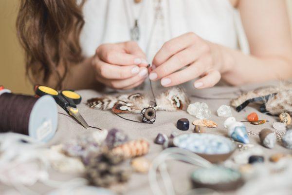 Woman hands making handmade gemstone jewelry